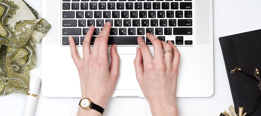 photo of person typing on a laptop