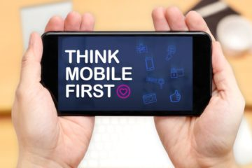 image of mobile phone with Think Mobile First on the screen