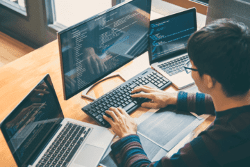 Man coding with PHP, JS & HTML
